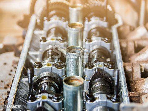 istock select focus repairing of engine closeup of camshaft and valves 1018586752
