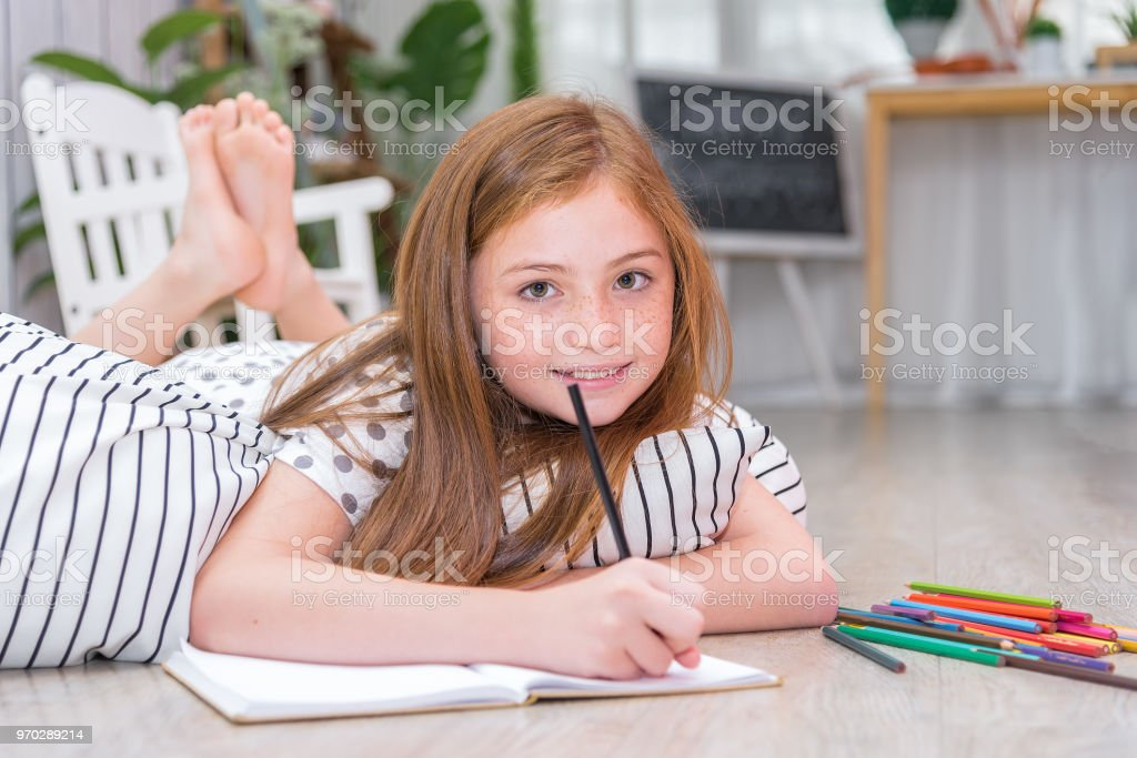 Selected Focus On Little Girls Eyes Laying Down On The Floor