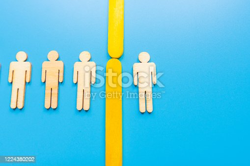 898212112 istock photo Selected wooden figure on blue background. The concept of finding an employee in business. HR manager search employee. Group leader. 1224380202