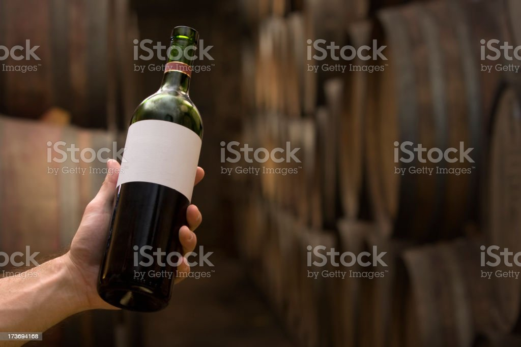 Selecting a bottle at the wine cellar stock photo