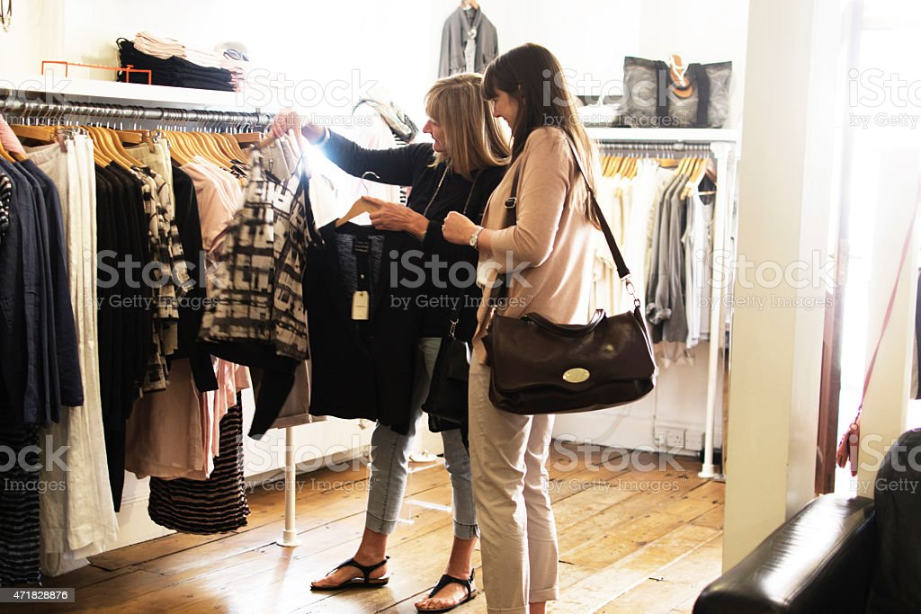 Selecting clothing stock photo