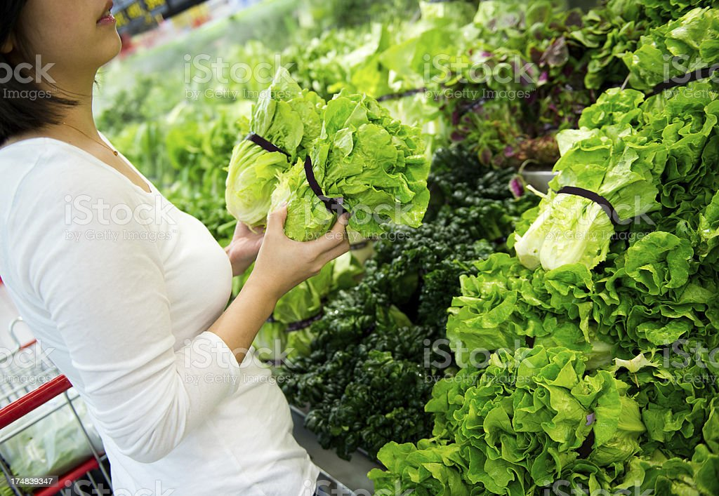 selecting lettuces royalty-free stock photo