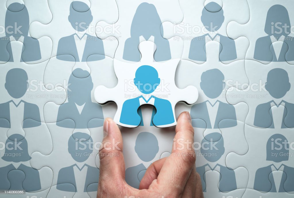 Selecting person and building team. Business people relationship concept. Connecting last jigsaw puzzle piece. Adult Stock Photo