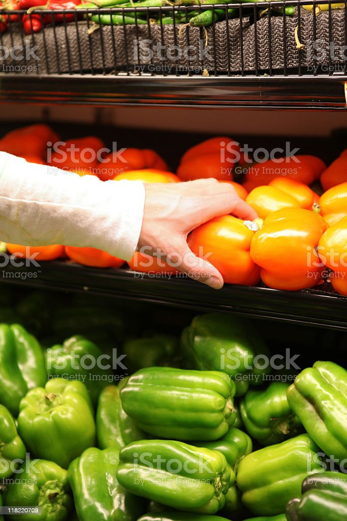 Selecting produce at the supermarket stock photo