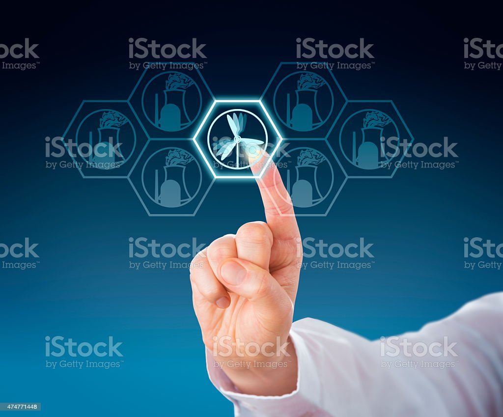 Selecting Wind Power Over Nuclear Energy By Touch stock photo