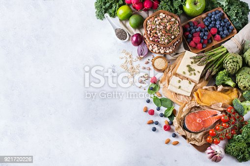Selection assortment of healthy balanced food for heart, diet, detox, salmon fish, chicken breast, tofu, seeds nuts broccoli green spinach asparagus, berries