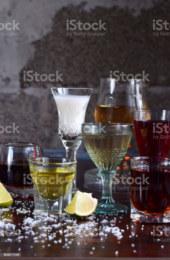 Selection of alcoholic drinks. Set of wine, brandy, liqueur, tincture, cognac, whiskey in glasses. Large variety of alcohol and spirits for making cocktails and drink. Copy space for text stock photo