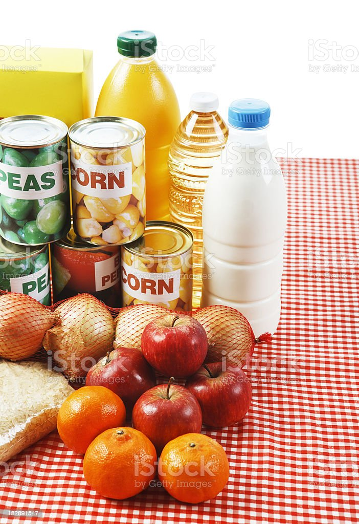 Selection of basic fresh and packaged foods, isolated on white stock photo