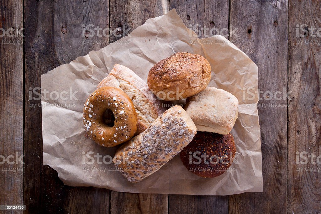 Selection of Bread Rolls on Rustic Wood stock photo