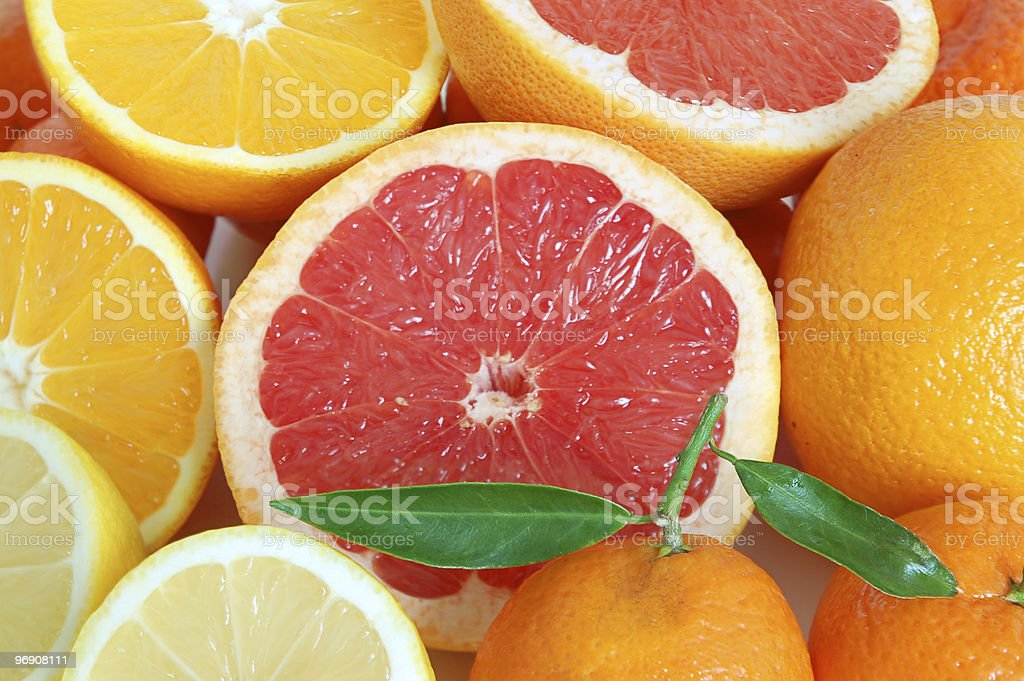 Selection of citrus fruits including lemons and grapefruit royalty-free stock photo