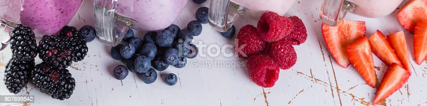 648804276 istock photo Selection of colorful detox berry drinks on wood background 807699542