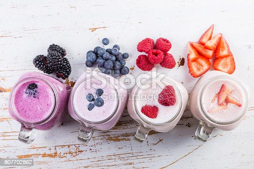 648804276istockphoto Selection of colorful detox berry drinks on wood background 807702862