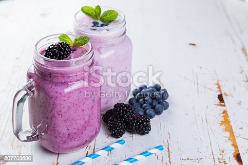 648804276 istock photo Selection of colorful detox berry drinks on wood background 807703536