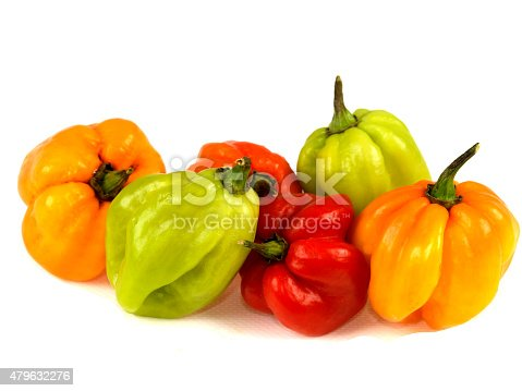 a DSLR royalty free digital image of a selection of colourful hot and spicy Scotch Bonnet chillies isolated against white, using as a cooking ingredient to spice up food and add a hot fiery taste to cooking, extremely hot chillies in different colours