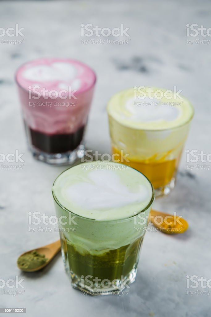 Selection of colorful super lattes on marble background stock photo