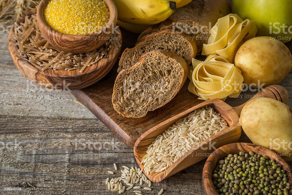 Selection of comptex carbohydrates sources on wood background stock photo