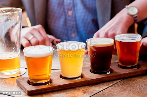 Selection of craft beers in a flight ready for tasting