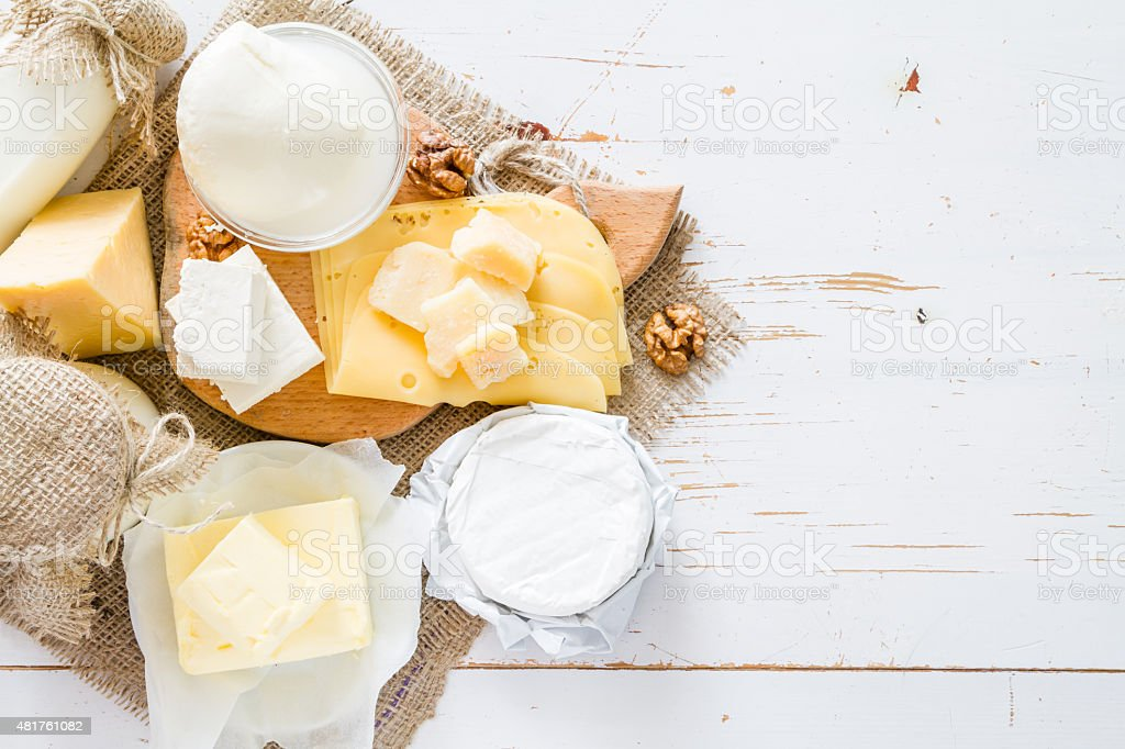 Selection of dairy products - cheese, yogurt, butter, nuts stock photo