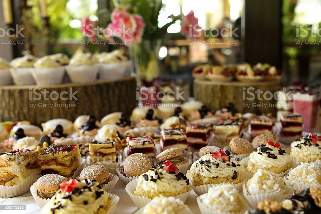Selection of decorative desserts on a buffet table stock photo