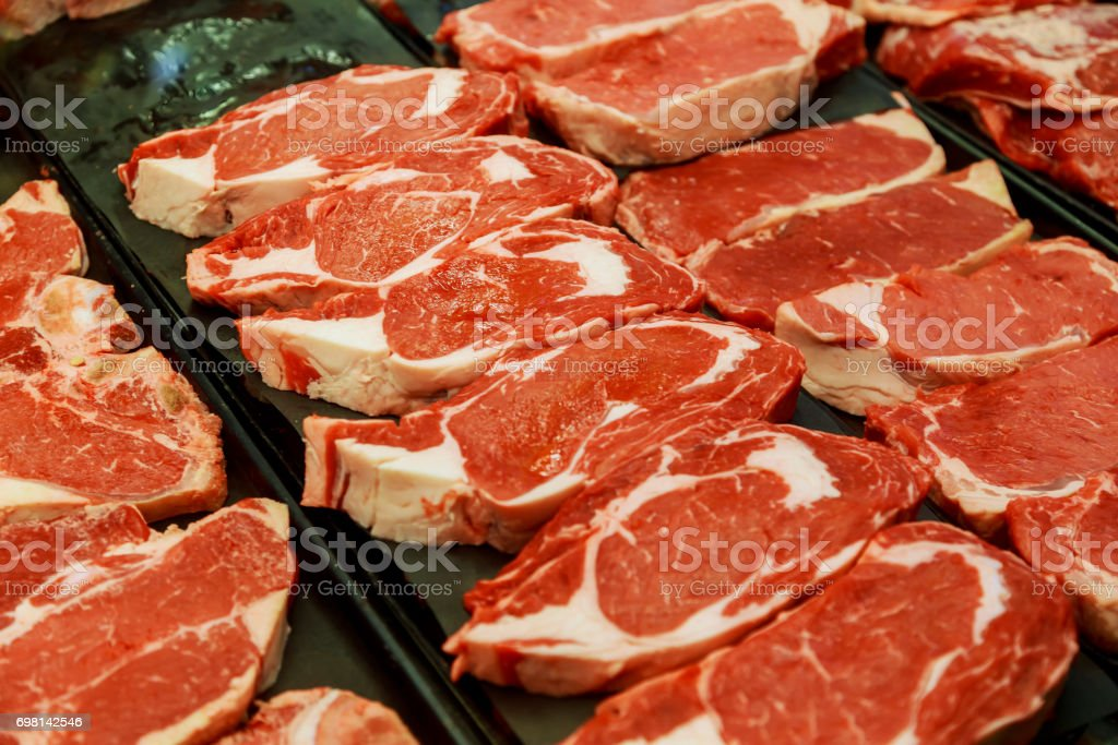 Selection of different cuts of fresh raw red meat in supermarket stock photo