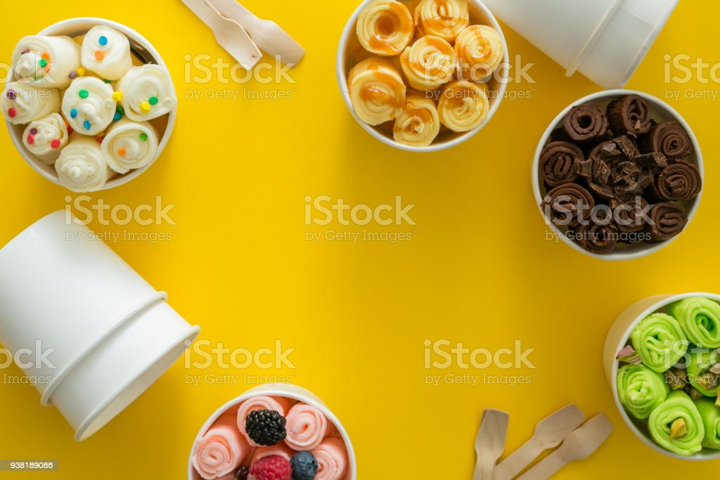 Selection Of Different Rolled Ice Creams In Cone Cups Stock