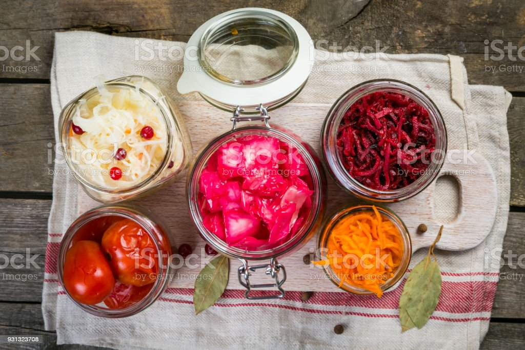 Selection of fermented food - carrot, cabbage, tomatoes, beetroot, copy space stock photo