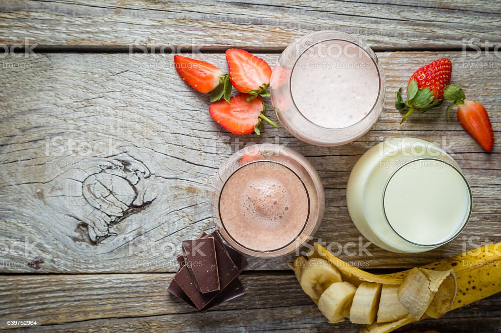 Selection of flavoured milk - strawberry, chocolate, banana stock photo