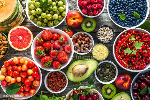 904734850istockphoto Selection of food. Healthy superfood, detox antioxidant diet with fruits and assorted berries. Fresh nutrition on table. Breakfast in a bowls with different ingredients. 1067777580
