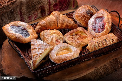 istock Selection of French & Danish pastries on a Wicker basket 469380314