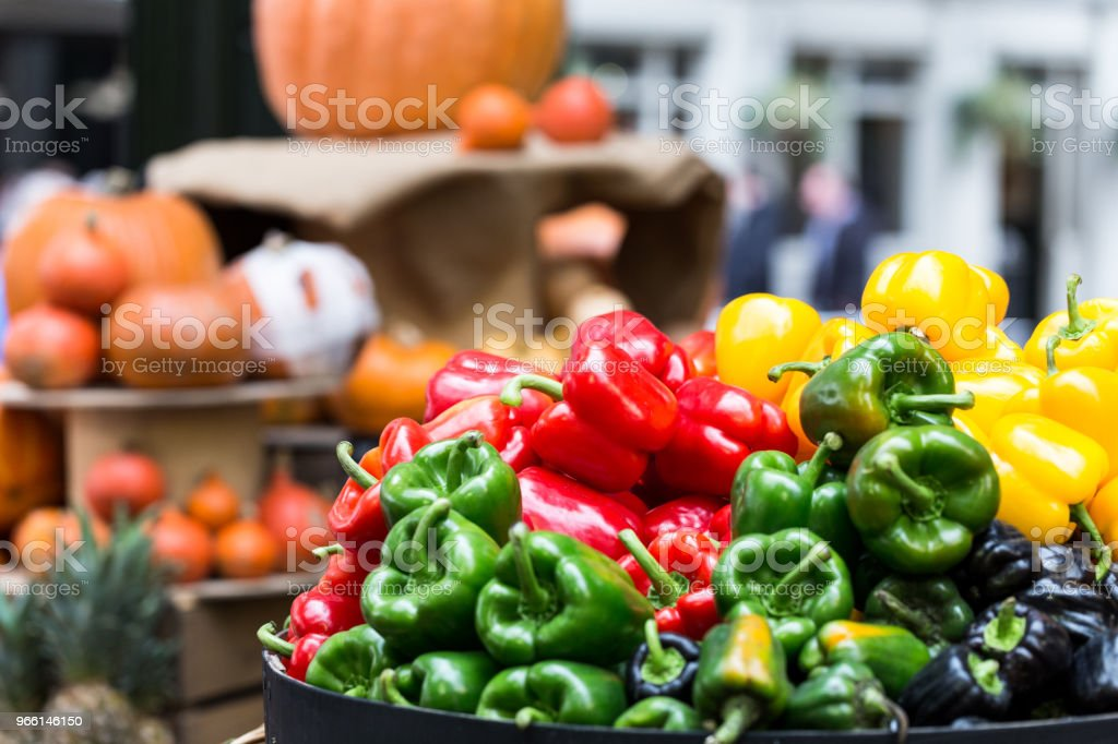 Selection of fresh peppers and vegetables on display at food market - Royalty-free Agriculture Stock Photo