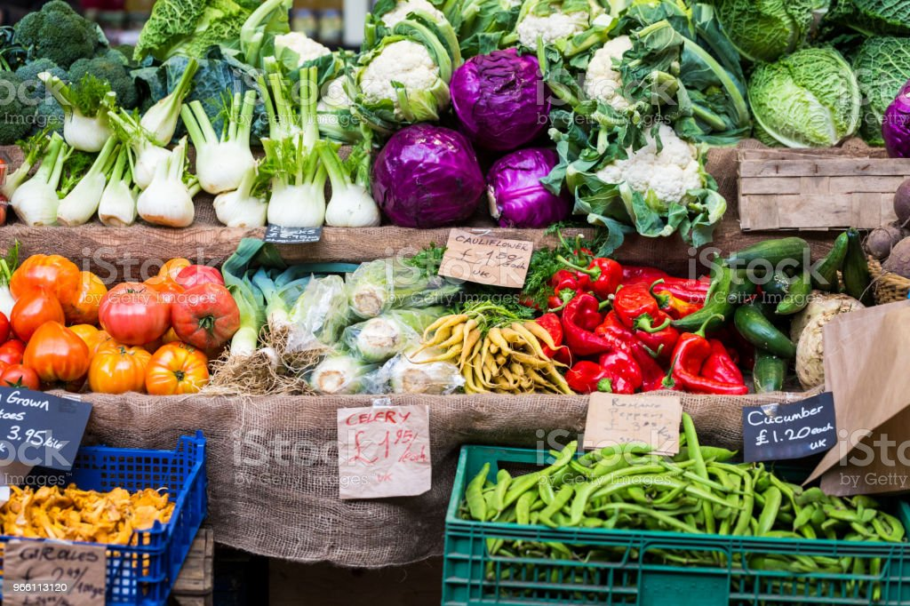 Selection of fresh vegetables including fennel, chillies and red cabbages on display at food market - Royalty-free Agriculture Stock Photo
