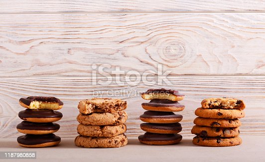 Selection of girl scout cookies over white wooden background