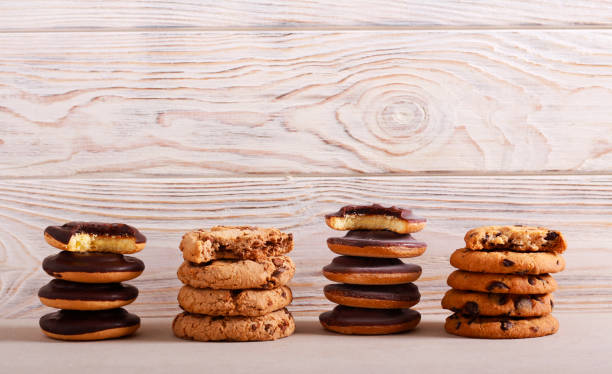 Selection of girl scout cookies Selection of girl scout cookies over white wooden background cookie stock pictures, royalty-free photos & images