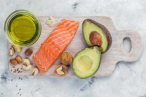 Selection of good fat sources - healthy eating concept. Ketogenic diet concept, copy space