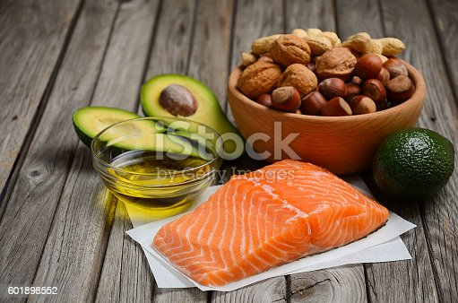 Selection of healthy fat sources. Rustic background.