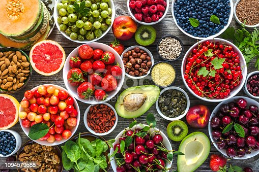 904734850istockphoto Selection of healthy food. Superfoods, various fruits and assorted berries, nuts and seeds. 1094579588