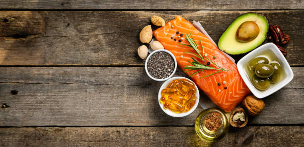 Selection of healthy unsaturated fats, omega 3 Selection of healthy unsaturated fats, omega 3 - fish, avocado, olives, nuts and seeds ketogenic diet stock pictures, royalty-free photos & images
