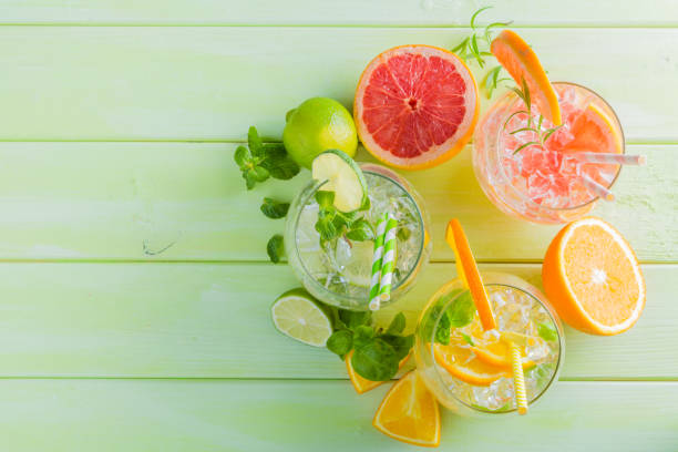 selection of infused water for detox - grapefruit cocktail stock photos and pictures