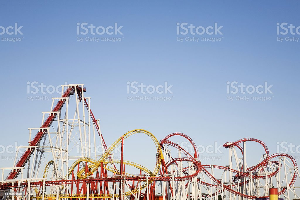 A selection of large roller coasters intertwined together stock photo