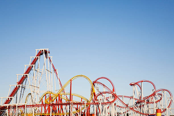 a selection of large roller coasters intertwined together - attractiepark stockfoto's en -beelden