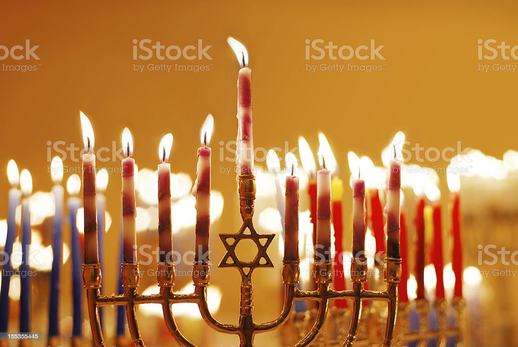 Selection of light red Hanukkah candles stock photo