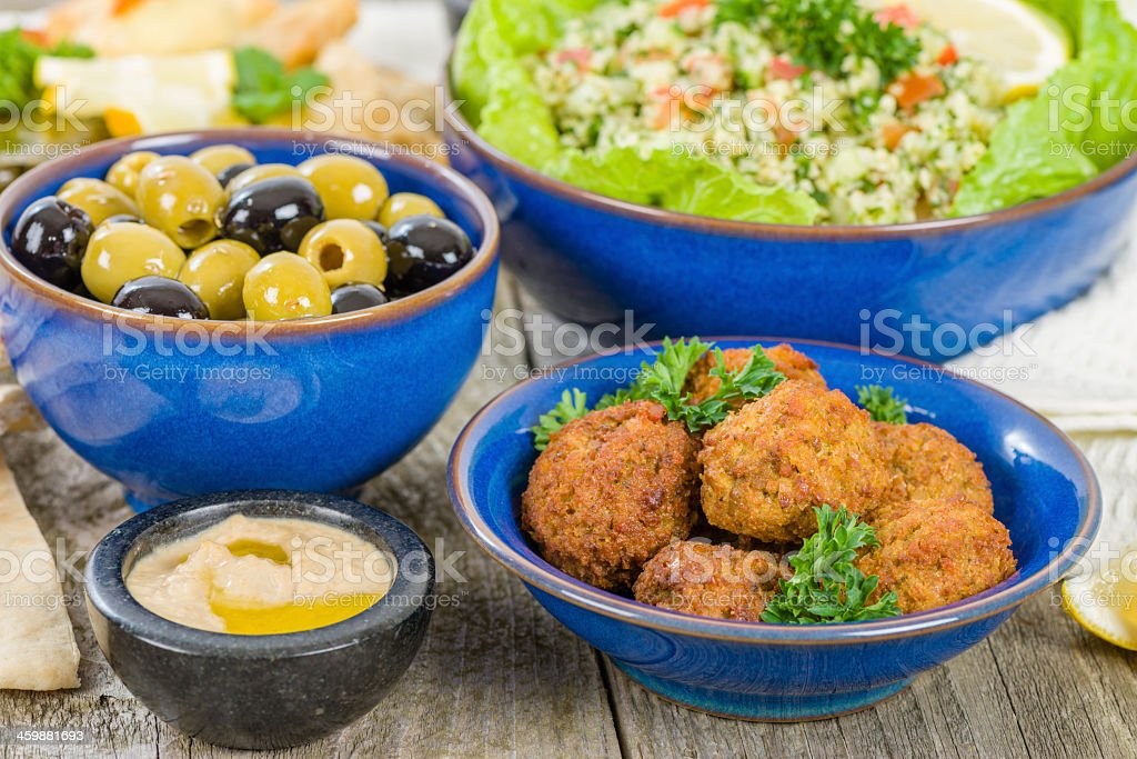 Selection of mezze on a wooden table stock photo