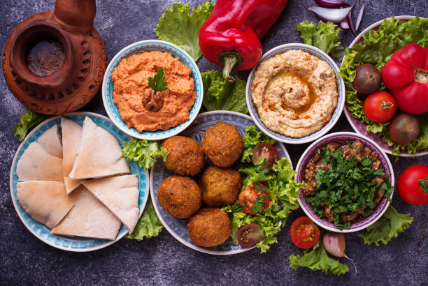 Selection of Middle eastern or Arabic dishes. Selection of Middle eastern or Arabic dishes. Falafel, hummus, pita and  muhammara. Top view east africa stock pictures, royalty-free photos & images