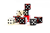 Selection of multicoloured dice, some stacked on top of each other, isolated on white background