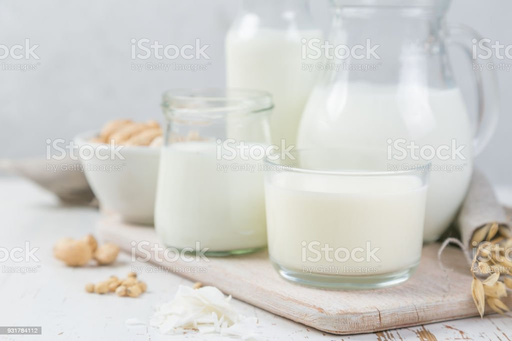 Selection of non-dairy milk alternatives in different bottles. Lactose free milk. healthy lifestyle concept stock photo