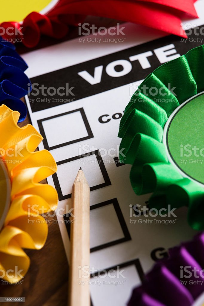 Selection Of Political Rossettes On Ballot Paper For Political Election stock photo