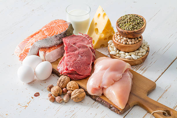 selection of protein sources in kitchen background - protein stock photos and pictures