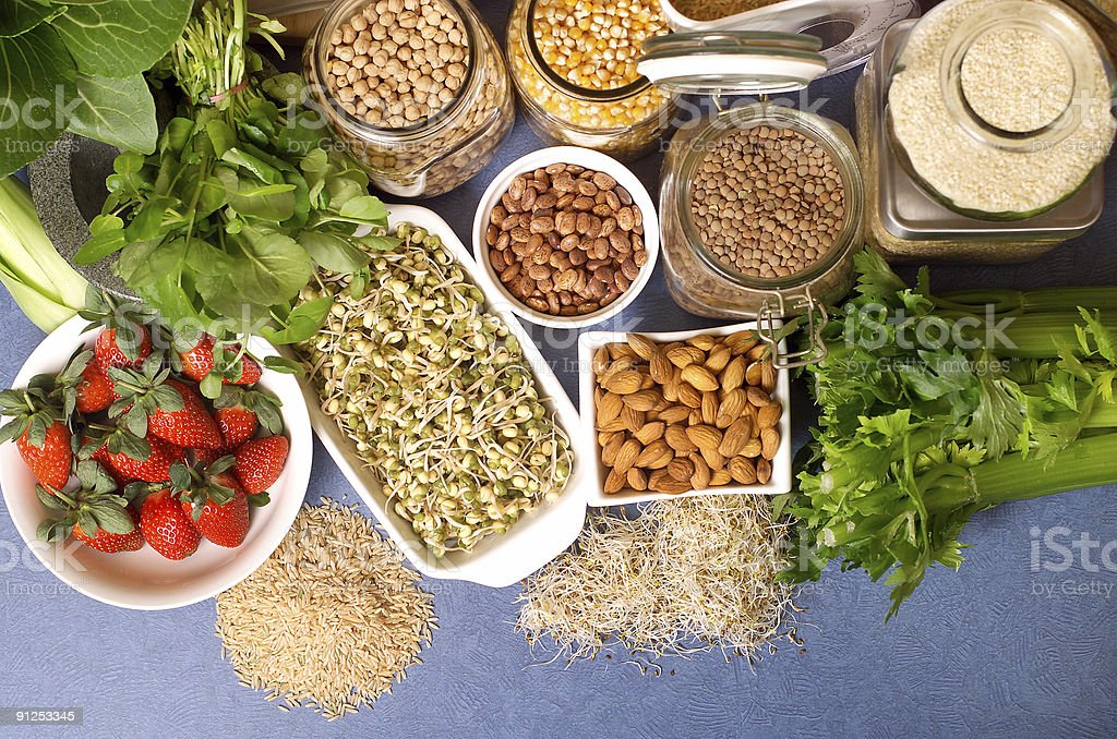 Selection of pulses and fresh foods displayed on blue table royalty-free stock photo