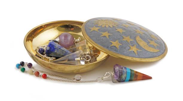 selection of radionics dowsing pendants - pendulum stock photos and pictures