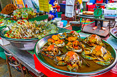 Selection of seafood Thai food and Chinese cuisine in street food old market in China Town Bangkok Thailand.